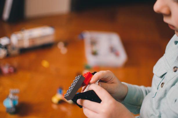 kid playing lego